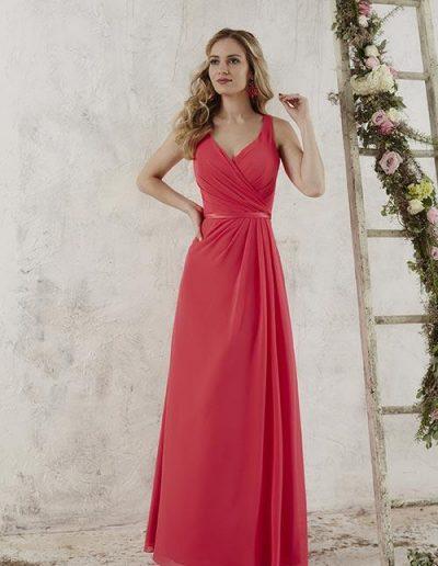 Chiffon gown has a pleated bodice and a v-neckline