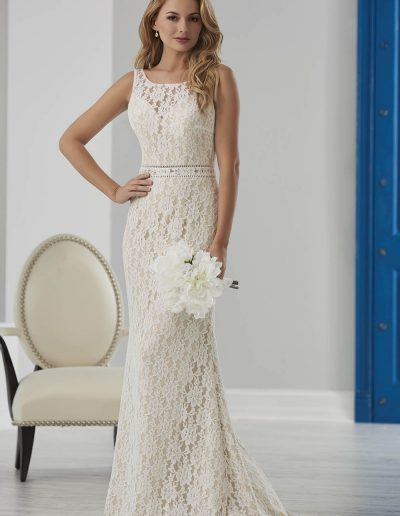 Lace gown features an illusion neckline and deep V back