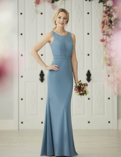 Racer neckline, fitted, jersey gown, features ladder detailing at the center front bodice