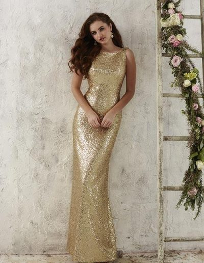 Sequined gown features a bateau neckline